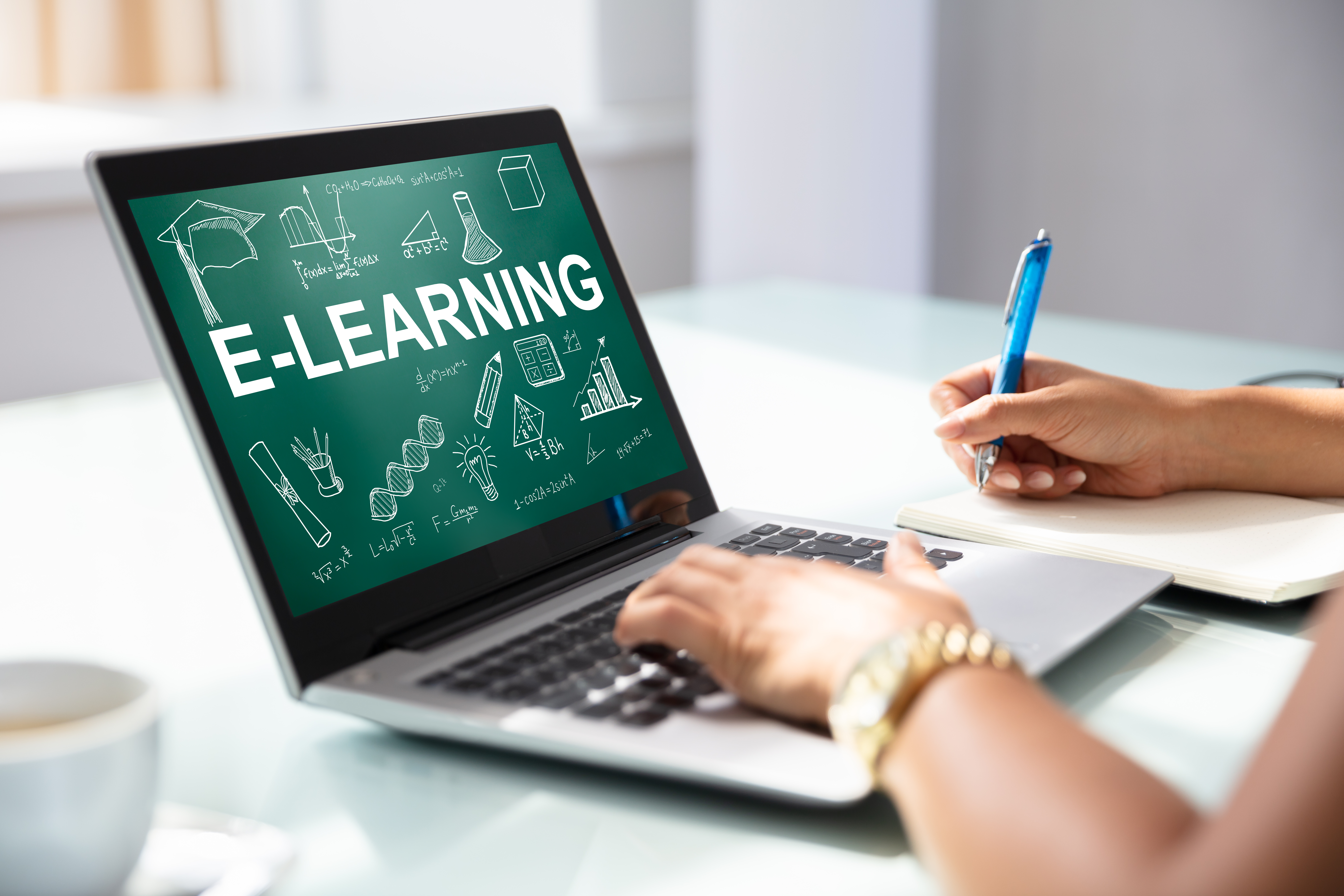 Businesswoman Using Laptop With E Learning Concept On Screen